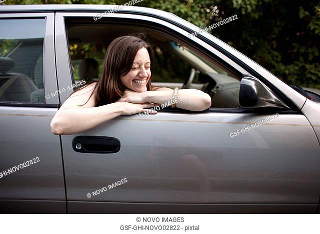 Laughing Woman Inside Car