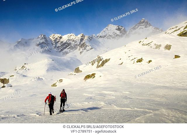 Alpinist are seeing the top of Valley of Forzo (Soana valley, Gran Paradiso National Park, Piedmont)