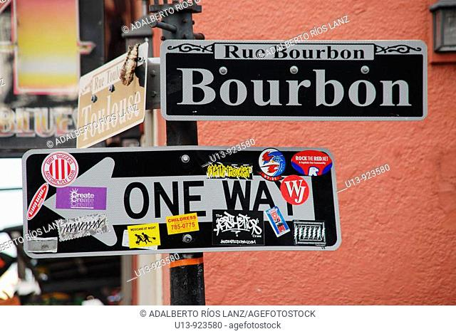 Street lamp or lantern and sign at the corner of Toulouse and Bourbon Street, French Quarter, New Orleans, Louisiana, USA