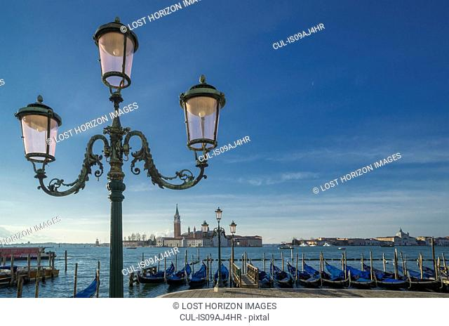 Gondolas and the Island of San Giorgio Maggiore, from St Mark's Square, Venice, Veneto, Italy