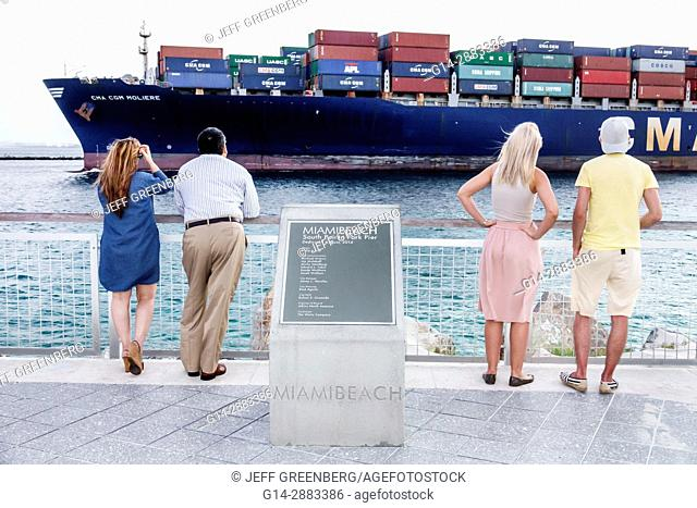 Florida, Miami Beach, South Pointe Park, Government Cut, shipping channel, cargo ship, container, departing Port, man, woman, watching, plaque