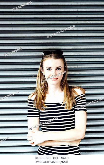 Portrait of young woman wearing striped dress