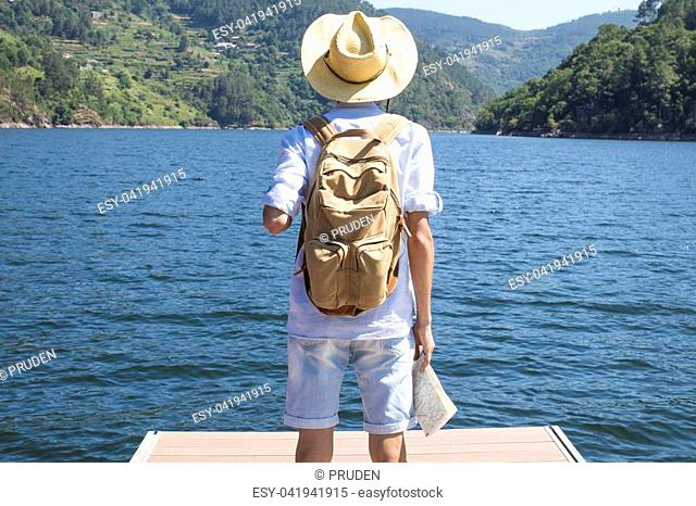 traveller with the backpack at the jetty