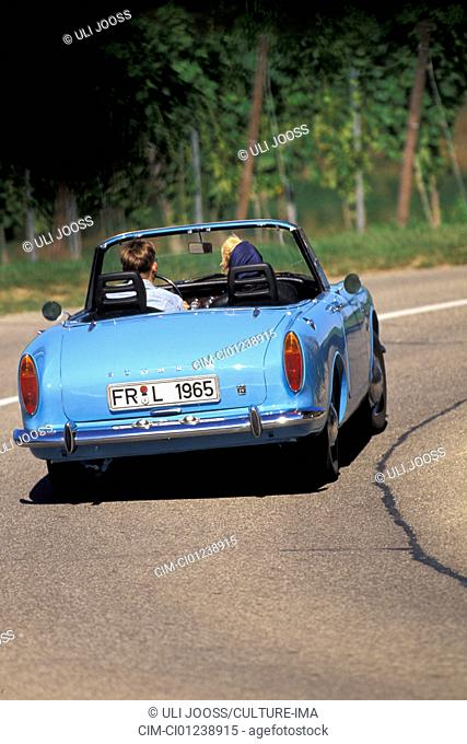 Car, Sunbeam Alpine, model year 1959-1968, vintage car, 1950s, fifties, 1960s, sixties, blue, convertible, convertible top, open, driving, diagonal back