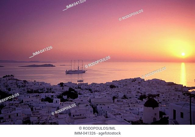 Cyclades, Mykonos Hora, general view of the town & sea at sunset, ship