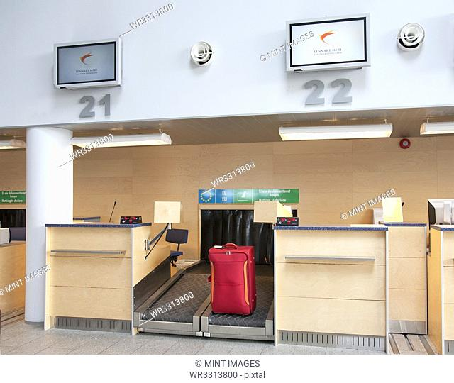 Luggage at an Airline Check-In Counter