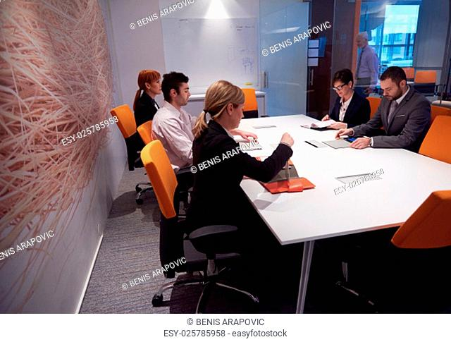 business people group with young adults and senior on meeting at modern bright office interior