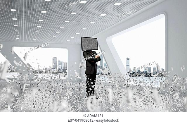 Businessman in suit with TV instead of head keeping arms crossed while standing among flying letters inside office building. 3D rendering