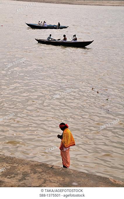 Sadhu praying by the Ganges river