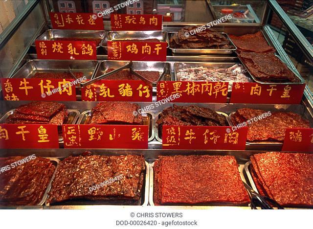 China, Macau, Rua da Felicidade, selection of Cantonese meats in a shop display