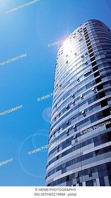 Modern skyscraper against blue sky