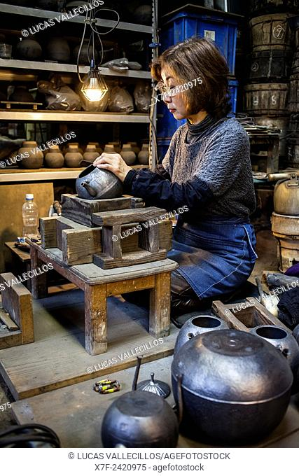 Morihisa Suzuki is putting the finishing touches at iron teapot or tetsubin, the only woman who has made teapots in the nearly 400 years of history that has...