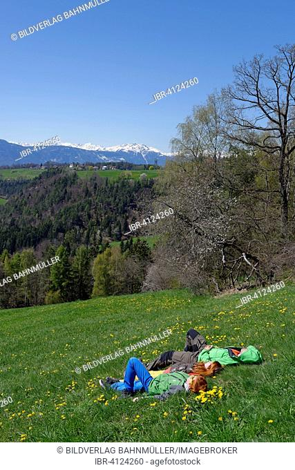 Hikers having a rest, near Wolfsgruben, Oberbozen on the Ritten Renon, Bolzano, South Tyrol, Italy