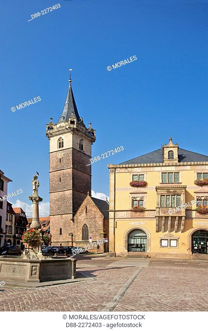 France,Bas Rhin,Obernai,market square,the Sainte Odile fountain,the City Hall and the the chapel tower (Belfry)