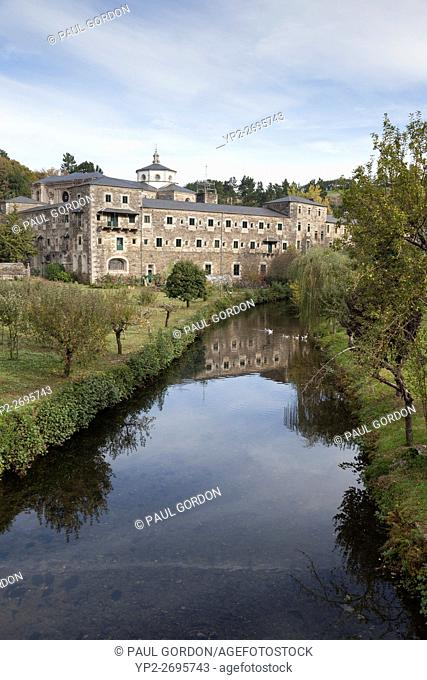 Samos, Spain: Apple orchards line the Sarria River at the Benedictine Monastery of San Xulián de Samos