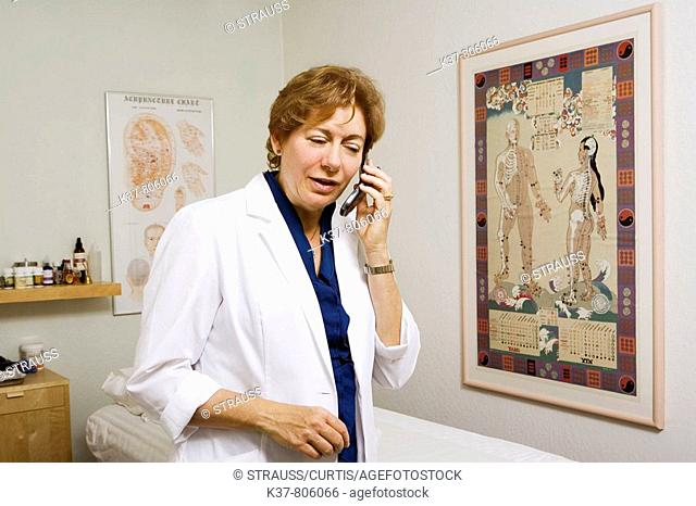 Acupuncture therapist on the phone