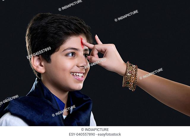 Sister applying tilak to her brother at Bhaidooj
