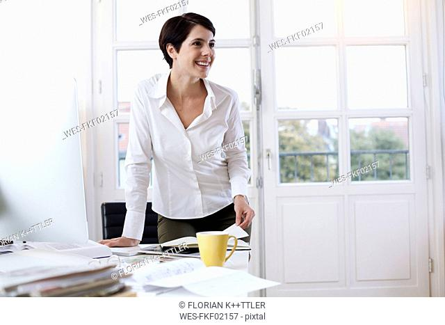 Smiling woman at desk in office