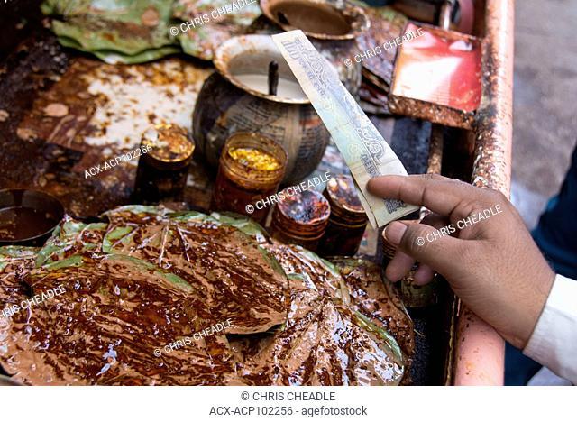 Selling betel nut leaf mixture In the Pink City, Jaipur, Rajastan, India