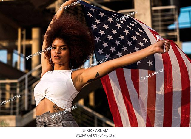 Portrait of young woman with American flag