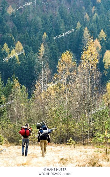 Austria, Salzburg County, Young couple hiking, rear view