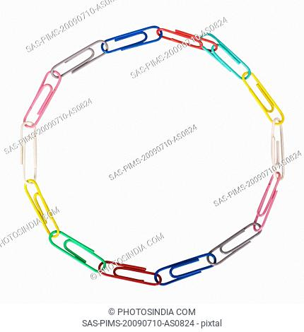 Assorted paper clips arranged in a circular shape