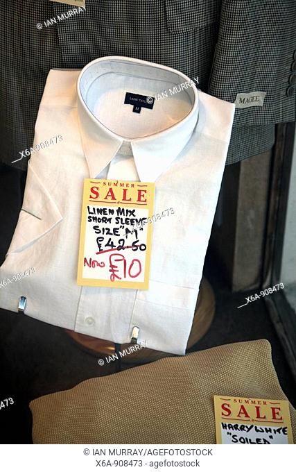 Gentleman's shirt marked at discount sale price in shop window