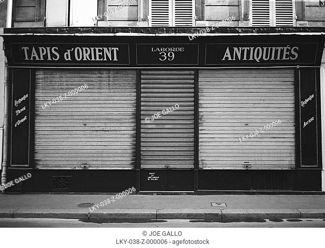 Closed facade of French antique shop