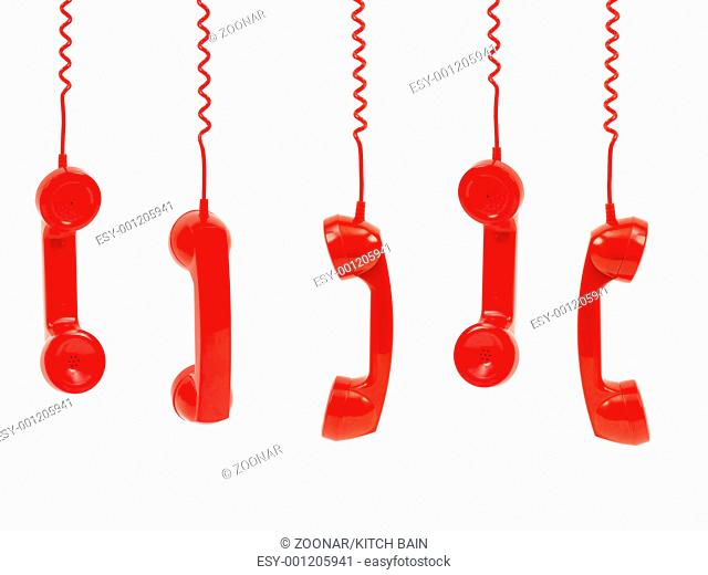 Hanging rotary telephone hand setsisolated against a white background