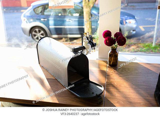 Cards and gifts are to be placed on this gift table at a wedding ceremony and reception with a mailbox and mini bride and groom on top
