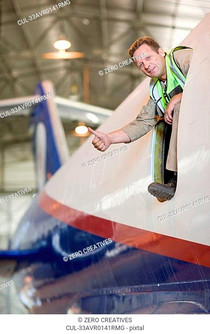 Aircraft worker giving ?thumbs up?