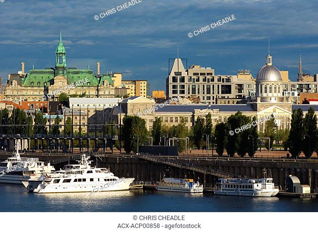 View across St. Lawrence to Old Montreal, city hall in background, Montreal, Quebec, Canada
