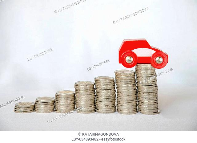 detail of coins and car on white background
