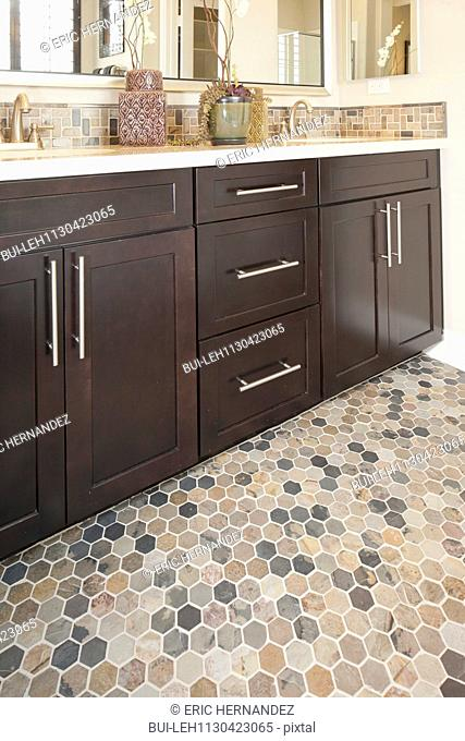 Brown cabinets in domestic bathroom