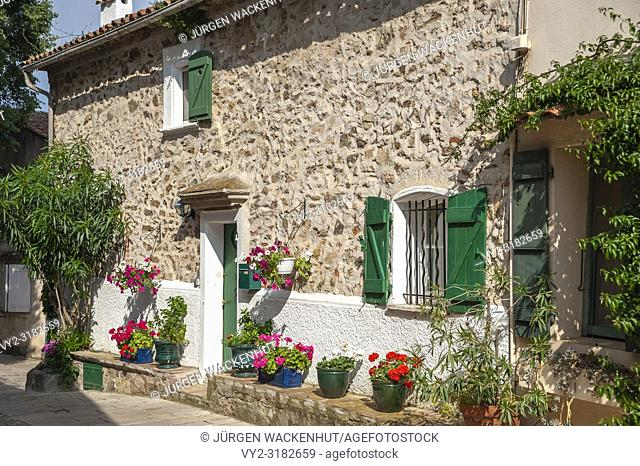Facade of a residential building in the old town, Grimaud-Village, Var, Provence-Alpes-Cote d`Azur, France, Europe
