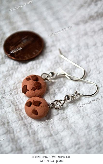 Small chocolate chip cookie earrings made from bakeable clay