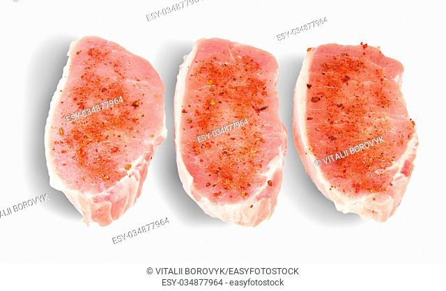 Three Pieces Of Raw Pork With Spices Isolated On White Background