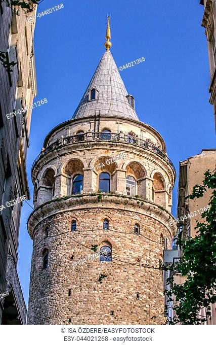 Unidentified people enjoy at top of Galata Tower, a medieval famous landmark stone tower architecture, in Beyoglu, Istanbul. 29 April 2018