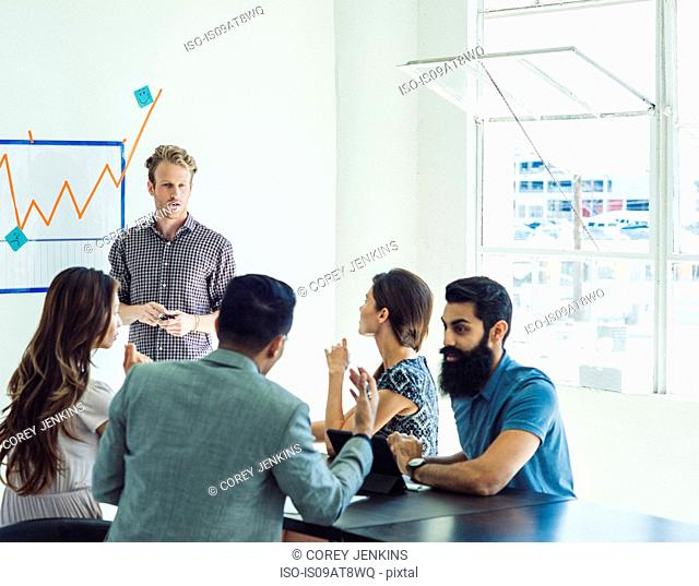 Business people in brainstorming meeting