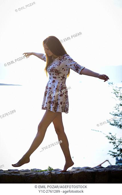 Young woman walking silhouette