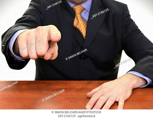 Businessman Pointing His Finger Directly at Camera