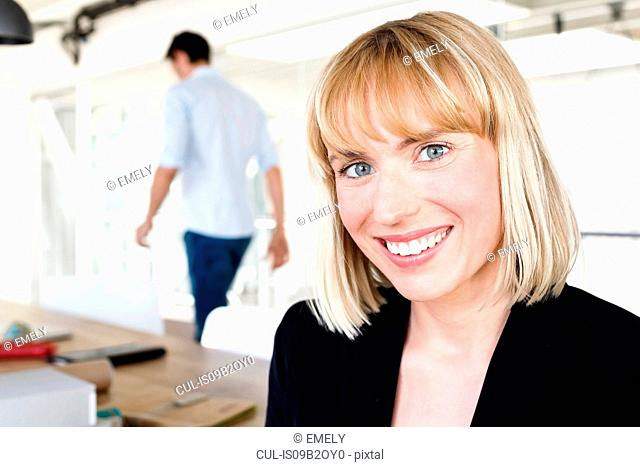 Portrait of business woman looking at camera smiling