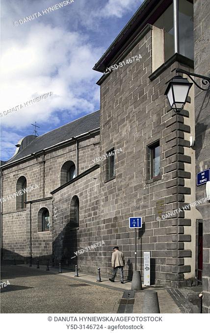 Man walking along wall of L'église Notre-Dame-de-Prospérité or église Notre-Dame de Montferrand, Rue du Temple, historic part of Montferrand - district of...