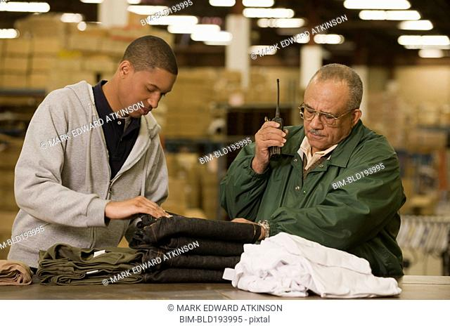 Manager talking with worker in warehouse