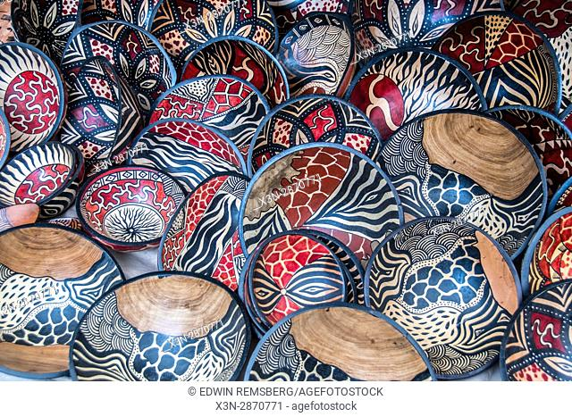 A large selection of wooden, hand-painted bowls are for sale at an open market in Cape Town, South Africa