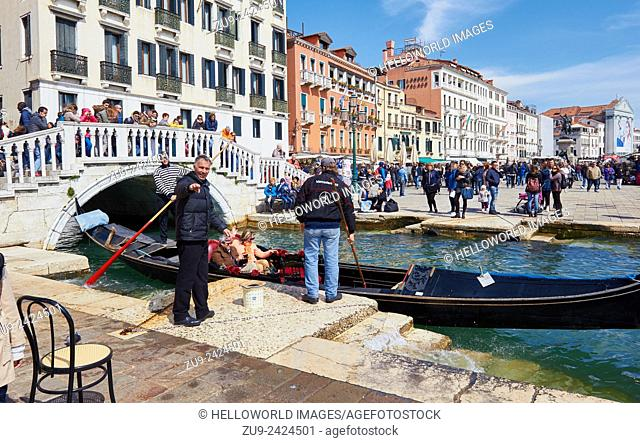 Unhappy gondoliers pointing at a photographer on Riva Degli Schiavoni on Easter Sunday. Venice, Veneto, Italy, Europe