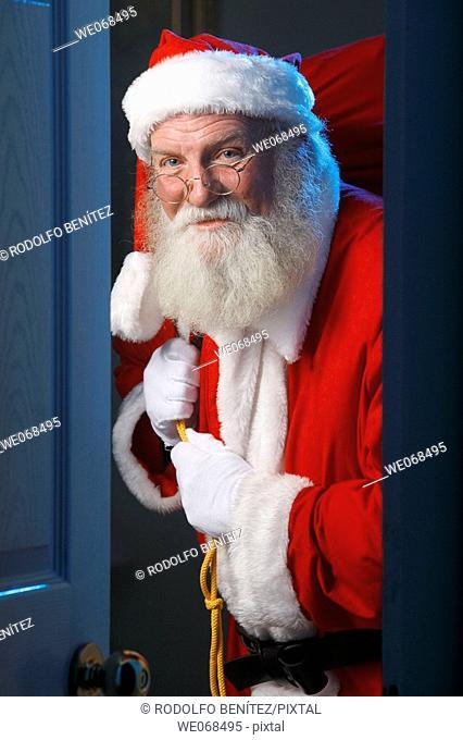 Santa enters a house