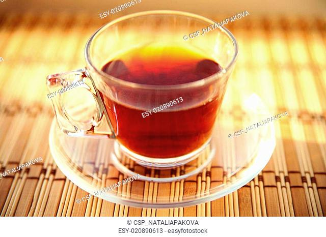 glass cup of black tea