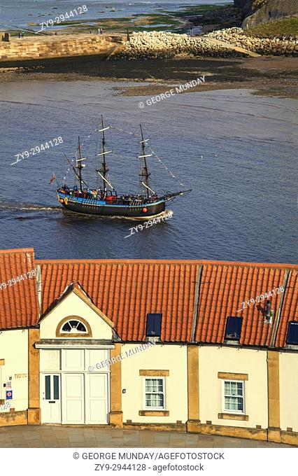 """The """"""""Bark Endeavour"""""""" a replica sailing ship, part of the Captain Cook Experience, sailing into Harbour,. Behind the Old Boatman's Shelter Apartments, Whitby"""