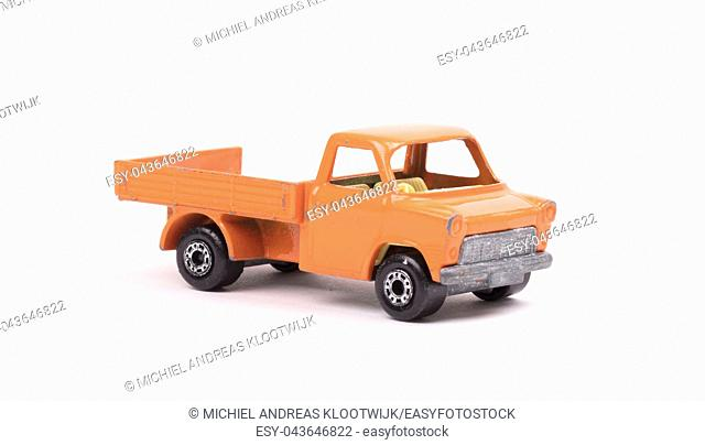 Orange metal toy car, pickup truck, isolated on white